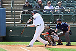 SIOUX FALLS, SD - JUNE 2:  Jared Clark #15 from the Sioux Falls Canaries hammers the ball for a three run home run against the Wichita Wingnuts in the bottom of the sixth inning Sunday afternoon at the Sioux Falls Stadium. (Photo by Dave Eggen/Inertia)