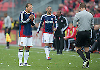 14 April 2012: Chivas USA forward Alejandro Moreno #15 appeals to the referee Mark Geiger after showing Chivas USA midfielder Ryan Smith #22 a yellow card during a game between Chivas USA and Toronto FC at BMO Field in Toronto..Chivas USA won 1-0.