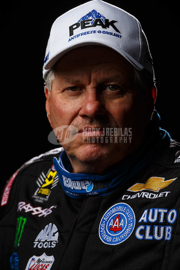 Feb 10, 2016; Pomona, CA, USA; NHRA funny car driver John Force poses for a portrait during media day at Auto Club Raceway at Pomona. Mandatory Credit: Mark J. Rebilas-USA TODAY Sports
