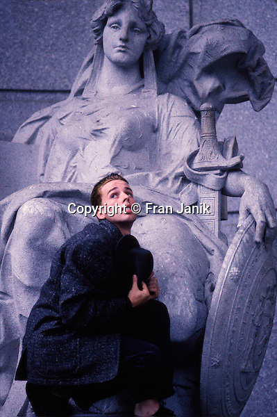 "The Actor Alexis Arquette kneels at the base of a statue on the steps of the Supreme Court building in lower Manhatten in New York city..The actor was in NYC in 1988 to film a PBS production of ""The Hollow Boy""."