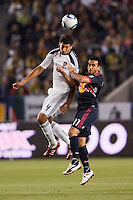 LA Galaxy defender Omar Gonzalez (4) battles New York Red Bulls midfielder Dwayne De Rosario (11). The LA Galaxy and Red Bulls of New York played to a 1-1 tie at Home Depot Center stadium in Carson, California on  May 7, 2011....