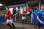 The players coming out of the dressing rooms before Gala Fairydean Rovers (in red) host Gretna 2008 in a Scottish Lowland League match at Netherdale, Galashiels. The home club were established in 2013 through a merger of Gala Fairydean, one of Scotland's most successful non-League clubs, and local amateur club Gala Rovers. The visitors were a 'phoenix' club set up in the wake of the collapse of the original club, which had competed for a short time in the 2000s before going bankrupt. The home aside won this encounter 4-1 watched by a crowd of 120 at a stadium which features one of the country's most notable stands, a listed building constructed in 1964 but at the time of this fixture closed to spectators on safety grounds.
