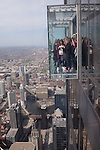 People out on the Ledge at the Willis Tower Skydeck, Chicago, IL