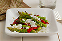 Asparagus and red peppers cooked with cheese crumbles
