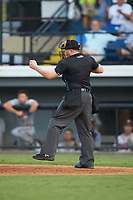 Home plate umpire West Hyer calls a batter out on strikes during the Appalachian League game between the Danville Braves and the Burlington Royals at Burlington Athletic Stadium on August 9, 2019 in Burlington, North Carolina. The Royals defeated the Braves 6-0. (Brian Westerholt/Four Seam Images)