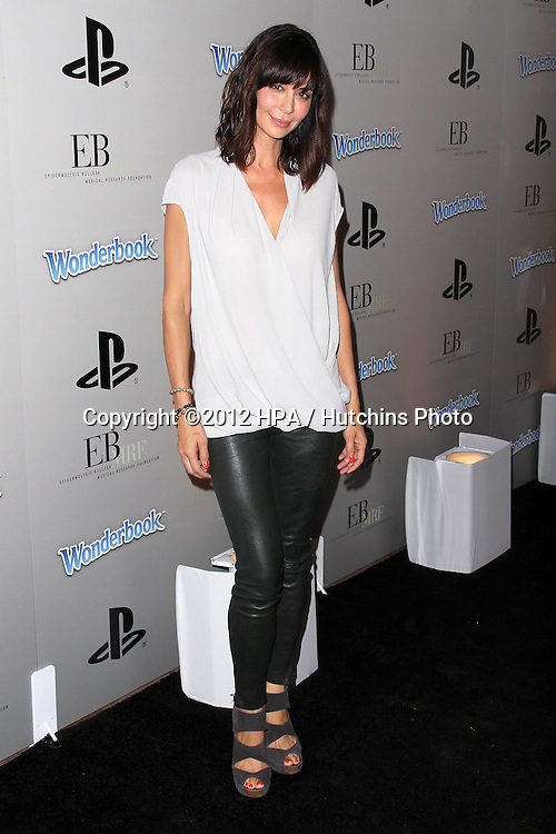 LOS ANGELES - OCT 27:  Catherine Bell arrives at EBMRF And PlayStation Epic Halloween Bash at Private Location on October 27, 2012 in Los Angeles, CA