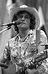 Ramblin' Jack Elliott, 37-7-15A, Bread & Roses Festival, 9/3/78.Greek Theater, Berkeley, CA. American folk singer and performer. Woody Guthrie had the greatest influence on Jack. Woody's son, Arlo, said that because of his father's illness and early death, he never really got to know him, but learned Woody's songs and performing style from Elliott.<br />