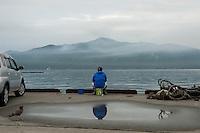 A landscape view of a fisherman at Miyako Bay during reconstruction efforts following the 311 Tohoku Tsunami in Miyako, Japan  © LAN