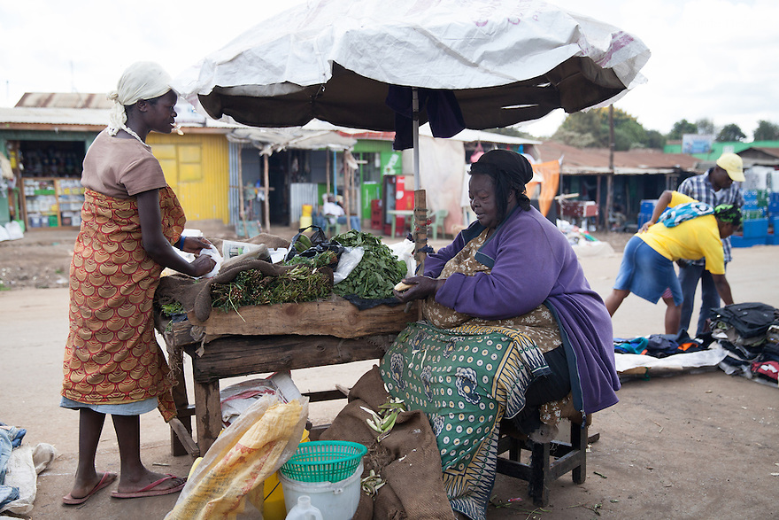 """Mama Safi"" sells vegetables and fried potatoes in the street in front of her home in Kawangware slum in Nairobi, Kenya on March 22, 2013. Susan Kalai aka ""Mama Safi"" is a 53 year old Kenyan woman with severe morbid obesity living in Kawangware slum in Nairobi, Kenya. She lives on less than $1 USD a day, selling vegetables and fried potatoes in the street in front of her house. She has 7 children, the youngest one is 9 years old. She suffers from several obesity-related diseases. She can't walk, has a lot of pain in her legs and back and also has difficulties to breathe. She says ""I was born big. I was always like this. Both my parents and my sister are big too. So for me it's normal. Nothing is wrong with me"". She has no knowledge about obesity and she can't go to the doctor to get treated because she has no money to pay for it. She is afraid to die of a heart attack. Although large parts of Africa are plagued with malnutrition, the continent must now also deal with another problem: obesity. Obesity is fast becoming a serious problem in Kenya and even the poorest are now being affected. Obesity rates are climbing around the world and they are rising faster in developing countries than in developed ones. (Photo by Benedicte Desrus)"
