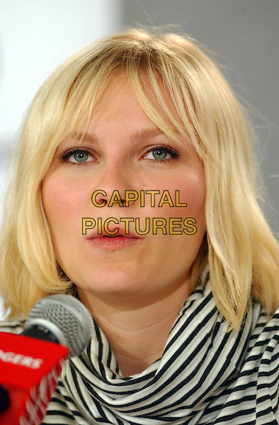 KIRSTEN DUNST.2005 Toronto Film Festival, Toronto, Ontario.September 11th, 2005.Photo Credit: George Shepherd/AdMedia.headshot portrait black white stripes.www.capitalpictures.com.sales@capitalpictures.com.© Capital Pictures.