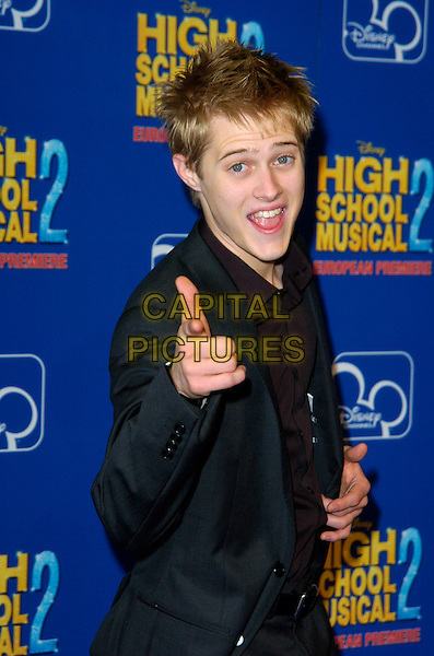 "LUCAS GRABEEL.Attends the European Premiere of Disney's ""High School Musical 2"" at the O2 Centre, Greenwich, .London, England, September 2nd 2007..half length black suit finger gesture.CAP/CAN.©Can Nguyen/Capital Pictures"