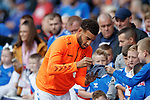 28.07.2019 Rangers v Derby County: Connor Goldson signs autographs