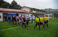 The teams walk out for the Oceania Football Championship final (first leg) football match between Team Wellington and Lautoka FC at David Farrington Park in Wellington, New Zealand on Sunday, 13 May 2018. Photo: Dave Lintott / lintottphoto.co.nz