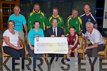 On Monday evening outside the Brandon Hotel Tralee members of  Tralee Boxing Club presented a cheque of €9,000.84 to Gerry Cully (fundraising manager Children's Hospital Crumlin) and also James Rusk Tralee presented €100 towards the Donal Walsh Memorial Fund. Front l-t: Elma Walsh, Lisa Carolan, Gerry Cully, James Rusk and Finbar Walsh. Back l-r: Noel kelliher, Seamus O'Mahony, pat O'Shea, Con O'Shea and Tommy Kelliher (all members of Tralee Boxing Club).