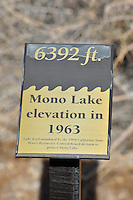 Sept. 5, 2010 - Mono Lake, California, U.S. - This sign notes the Mono LAke water line in 1963 as years of water diversion to Los Angels caused the water lever to drop over 25 vertical feet, causing the lake's ecosystem to collapse. Mono Lake is a majestic body of water covering about 70 square miles. It is an ancient lake, over 1 million years old -- one of the oldest lakes in North America. It has no outlet and no fish; instead it is home to trillions of brine shrimp and alkali flies. (Photo by Alan Greth/ZUMA Press)