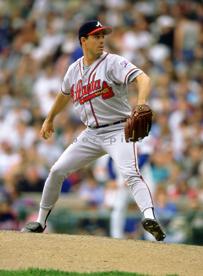Atlanta Braves Greg Maddux (31) during a game from his 1999 season at Wrigley Field in Chicago Illinois. Greg Maddux played for 23 years with 4 different teams, was a 8-time All-Star, a 4-time Cy Young award winner and was inducted to the Baseball Hall of Fame in 2014.