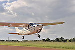Gaston Ntambo, a United Methodist missionary, pilots a Cessna P210 as it takes off from an airstrip in Kamina in the Democratic Republic of the Congo. Ntambo and the plane are part of the Wings of the Morning aviation ministry of The United Methodist Church, and provide life-saving access to isolated rural communities.