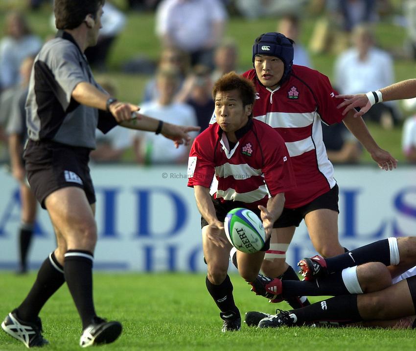 Photo: Richard Lane..Japan U21 v England U21. IRB Under U21 Rugby World Cup 2003 at Newbury RFC. 17/06/2003..Toshiaki Morita gets the ball away.