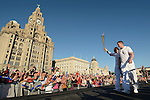 War veteran Craig Lundberg, blinded in Iraq while on active service, crarries the Olympic Torch across the River Mersey from Birkenhead to Liverpool, aboard the Royal Iris ferry, and ignites the cauldron at the Pier Head