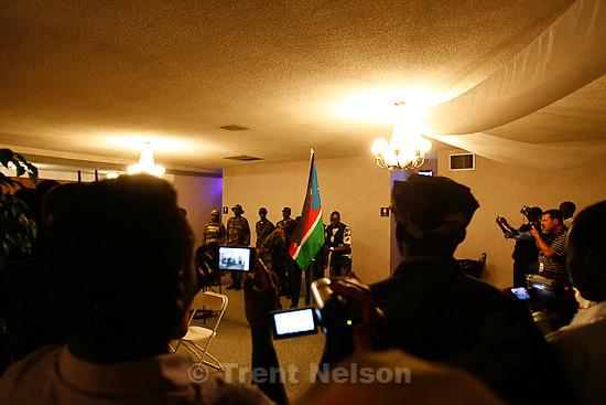 Trent Nelson  |  The Salt Lake Tribune.Cameras flock to the flag raising at the South Sudan Independence celebration in Salt Lake City, Utah, Saturday, July 9, 2011. scott winterton