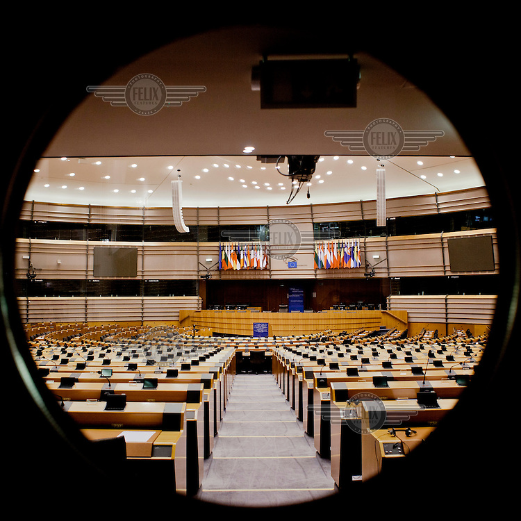 The empty plenary hall at the European Parliament in Brussels prior to the arrival of thousands of the parliament's employees who regularly travel between the three sites of government in Brussels, Strasbourg and Luxembourg.