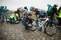 after having crashed on the slippery cobbles, Mark Cavendish (GBR/Ettix-QuickStep) is helped back to get back on his bike to continue racing<br /> <br /> 77th Gent-Wevelgem 2015