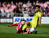 Cheltenham Town's Conor Thomas is fouled by Lincoln City's Tom Pett<br /> <br /> Photographer Chris Vaughan/CameraSport<br /> <br /> The EFL Sky Bet League Two - Lincoln City v Cheltenham Town - Saturday 13th April 2019 - Sincil Bank - Lincoln<br /> <br /> World Copyright &copy; 2019 CameraSport. All rights reserved. 43 Linden Ave. Countesthorpe. Leicester. England. LE8 5PG - Tel: +44 (0) 116 277 4147 - admin@camerasport.com - www.camerasport.com