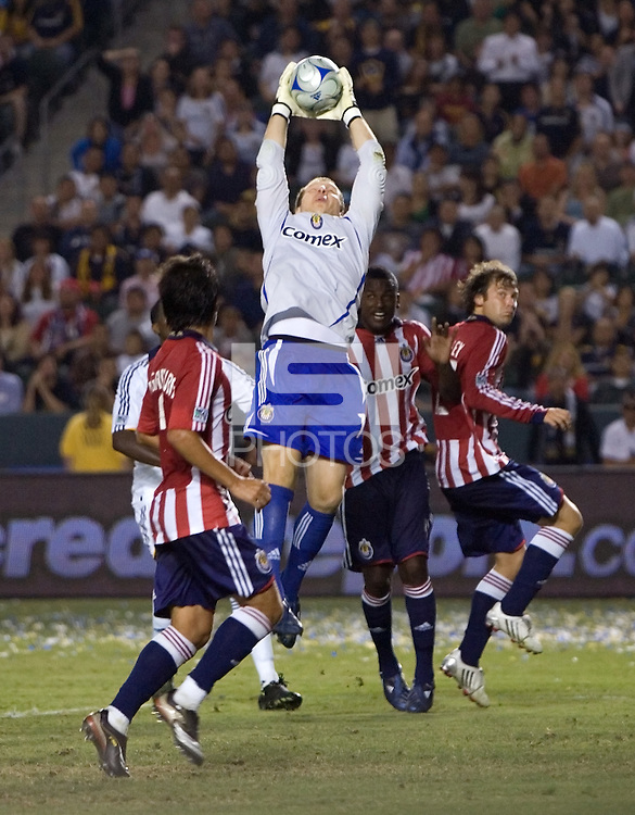 Chivas USA goalkeeper Brad Guzan (18) leaps high for a cross ball in the box. Chivas USA and the LA Galaxy played to a  1-1 draw at Home Depot Center stadium, in Carson, California on Thursday, July 10, 2008.