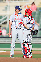 Hagerstown Suns catcher Spencer Kieboom (20) has a chat on the mound with starting pitcher Jake Johansen (36) during the game against the Kannapolis Intimidators at CMC-Northeast Stadium on May 31, 2014 in Kannapolis, North Carolina.  The Intimidators defeated the Suns 3-2 in game one of a double-header.  (Brian Westerholt/Four Seam Images)