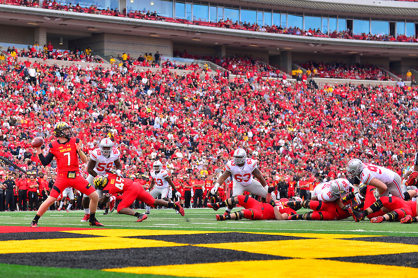Backup QB Caleb Rowe of the Terrapins throws the ball from his end zone. Ohio State trounced Maryland 52-24 during a game at the Capital One Field in Byrd Stadium, College Park, MD on Saturday, October 4, 2014.  Alan P. Santos/DC Sports Box