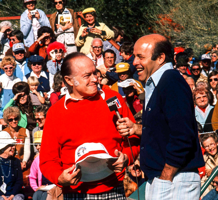 Comedian Bob Hope joins host Joe Garagiola for customary first tee banter on pro-am day at the 1977 at the Tucson  Open Golf Tournament at Tucson National Golf Club.
