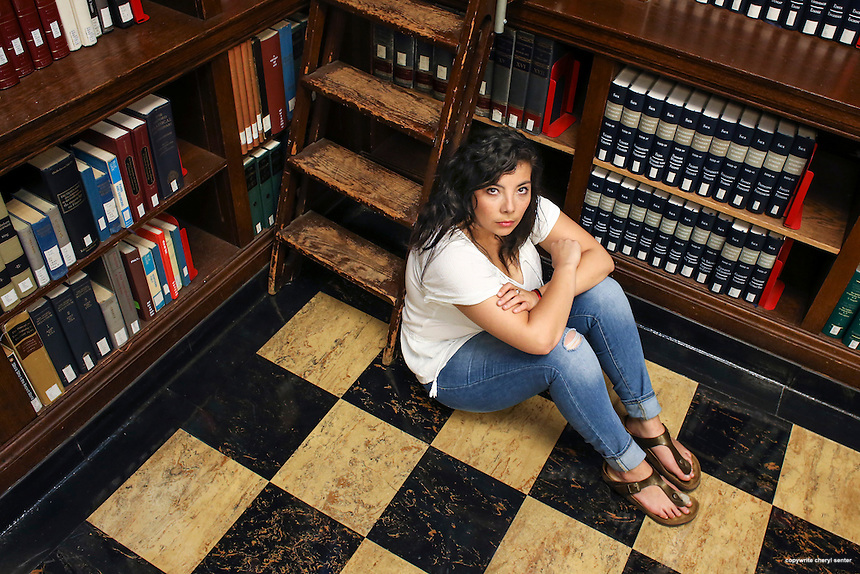 Melissa Padilla sitting in the Sherman Art Library part of the Dartmouth College Baker-Berry Library in Hanover, NH, Saturday, June 18, 2016.  CREDIT: Cheryl Senter for The New York Times