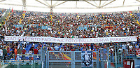 AS Roma fans show a banner in memory of photographer Gilberto Carbonari, recently died, prior to the start of the Italian Serie A football match between AS Roma and Lazio, at Rome's Olympic stadium, 22 September 2013.<br /> UPDATE IMAGES PRESS/Isabella Bonotto