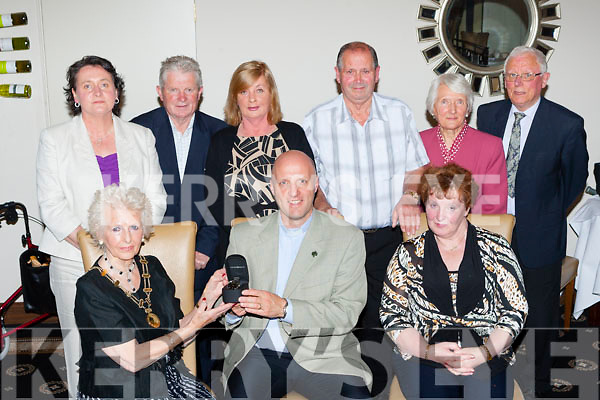 South Kerry Parkinson Society President Grace McRae presents  Rev Dr Laurence Graham a watch as a fond farewell and to thank him for all his  work with the group for the last number of years in the Killarney Royal Hotel on Monday evening  Front row l-r: Grace McRae, Rev Dr Laurence Graham an d Kathleen Crnin. back row: Paula Gilmore CEO, Michael Moynihan, Eileen Moynihan, Teddy Cronin, Jean Richie, Ed Richie