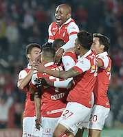 BOGOTÁ -COLOMBIA, 01-04-2014. Jugadores de Independiente Santa Fe celebran un gol en contra del Deportivo Pasto durante partido por la fecha 14 por la Liga Postobón  I 2014 jugado en el estadio Nemesio Camacho el Campín de la ciudad de Bogotá./ Independiente Santa Fe players celebrate a goal against Deportivo Pasto during match for the 14th date for the Postobon  League I 2014 played at Nemesio Camacho El Campin stadium in Bogotá city. Photo: VizzorImage/ Gabriel Aponte / Staff