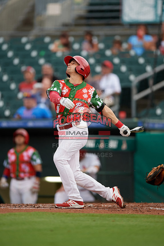 "Palm Beach Cardinals right fielder Thomas Spitz (8) follows through on a swing during a game against the Charlotte Stone Crabs on July 22, 2017 at Roger Dean Stadium in Palm Beach, Florida.  The Cardinals wore special ""Ugly Sweater"" jerseys for Christmas in July.  Charlotte defeated Palm Beach 5-2.  (Mike Janes/Four Seam Images)"