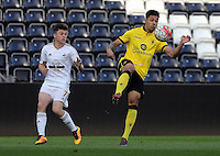 Pictured: Andre Green of Aston Villa (R) closely marked by Dan James of Swansea (L) Monday 25 April 2016<br /> Re: Play Off semi final, Swansea City AFC U21 v Aston Villa FC U21 at the Liberty Stadium, Swansea, UK