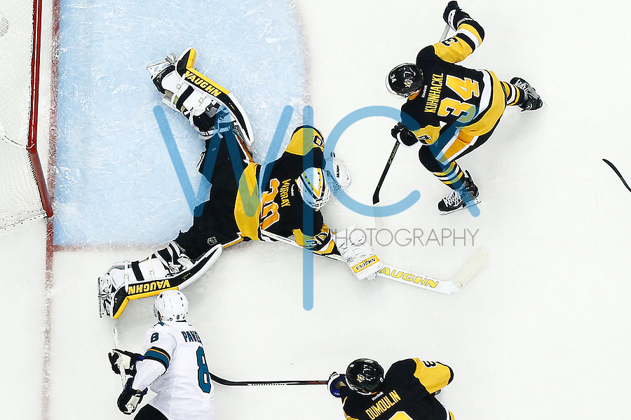 Matt Murray #30 of the Pittsburgh Penguins makes a save on Joe Pavelski #8 of the San Jose Sharks during game one of the Stanley Cup Final at Consol Energy Center in Pittsburgh, Pennslyvania on May 30, 2016. (Photo by Jared Wickerham / DKPS)