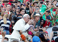 Papa Francesco bacia un bambino durante il suo incontro con i Ministranti delle diocesi tedesche in Piazza San Pietro, Citta' del Vaticano, 5 agosto 2014.<br /> Pope Francis kisses a baby during his meeting with German altar servers in St. Peter's square, Vatican, 5 August 2014.<br /> UPDATE IMAGES PRESS/Riccardo De Luca<br /> <br /> STRICTLY ONLY FOR EDITORIAL USE