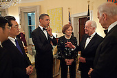 UNited States President Barack Obama, along with President Hu Jintao of China, former First Lady Rosalynn Carter, and Vice President Joseph Biden, listen to former President Jimmy Carter during a reception in the Yellow Oval Room in the Residence of the White House, Wednesday, January 19, 2011. .Mandatory Credit: Pete Souza - White House via CNP