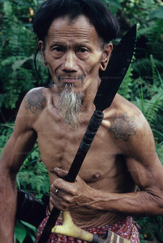 1989: Nomadic Penan native with blowpipe, wispy beard and mustache. Belaga district, Sarawak, Borneo<br />