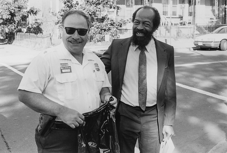Inspector Clande Beheler and Rev William Shipp Bynum cleaning 1st 8th NE, on Oct. 5, 1995. (Photo by Duncan Spencer/CQ Roll Call via Getty Images)