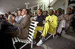 Lords cricket ground London a fan in yellow suit from Barbados. The English Season published by Pavilon Books 1987