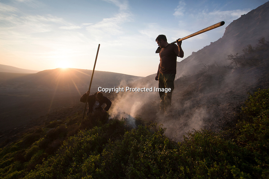10/05/16 <br /> <br /> After eight hours of tackling a fire high up in a remote part of the Peak District between Sheffield and Manchester, game-keepers, Luke Addy and Kieron Logan, take a moment to survey some 200 acres of precious heather moorland that was destroyed today after a BBQ started a fire in the valley below.<br /> <br /> Full story:   http://www.fstoppress.com/articles/peak-district-fire/<br /> <br /> .A small group of gamekeepers spent the night fighting a major blaze blaze covering two hundred acres of heather moorland close to the Derwent and Ladybower reservoirs in the Derbyshire Peak District.<br /> <br /> The fire, which broke out at around 1pm on Monday, is believed to have been started by a disposable barbecue, according to a spokesman for the reservoir, which quickly escalated into a major fire threatening the natural habitat of many wild animals and birds including red grouse, plovers, meadow pipits and hen harriers.<br /> <br /> Ten fire crews were called to tackle the flames, and remained on scene until dusk fell, leaving the job of managing the fire overnight to the gamekeepers on scene.<br /> <br /> Kieran Logan was one of the gamekeepers left battling the flames and he said moorland management policies implemented some 10 years ago by the landowners, The National Trust were also partly to blame.<br /> <br /> <br /> All Rights Reserved: F Stop Press Ltd. +44(0)1335 418365   +44 (0)7765 242650 www.fstoppress.com