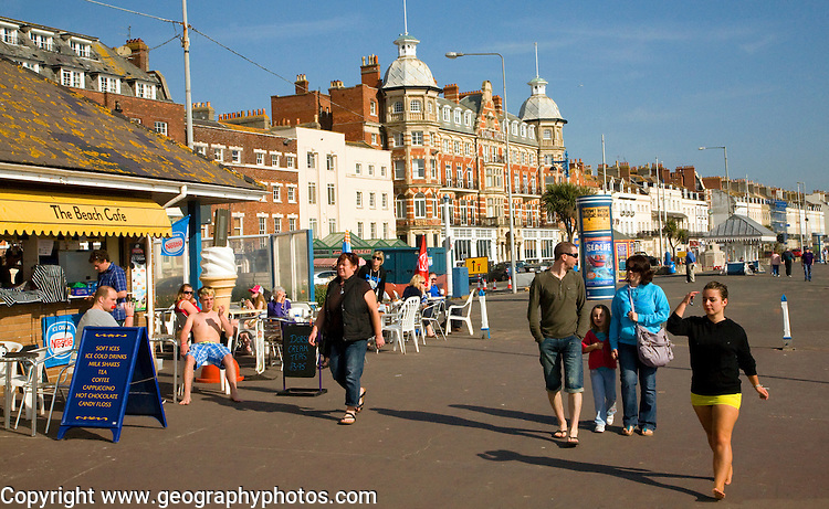 People walking along the promenade at Weymouth, Dorset, England