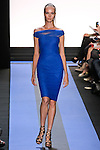 Kristy walks runway in a cobalt blue twisted tulle off the shoulder cocktail dress, by Monique Lhuillier, from the Monique Lhuillier Spring 2012 collection fashion show, during Mercedes-Benz Fashion Week Spring 2012.