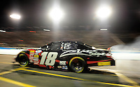 Apr 17, 2009; Avondale, AZ, USA; NASCAR Nationwide Series driver Kyle Busch pulls off pit road during the Bashas Supermarkets 200 at Phoenix International Raceway. Mandatory Credit: Mark J. Rebilas-