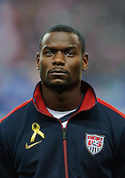 Maurice Edu of team USA stands for the national anthem prior to the friendly match France against USA at the Stade de France in Paris, France on November 11th, 2011.