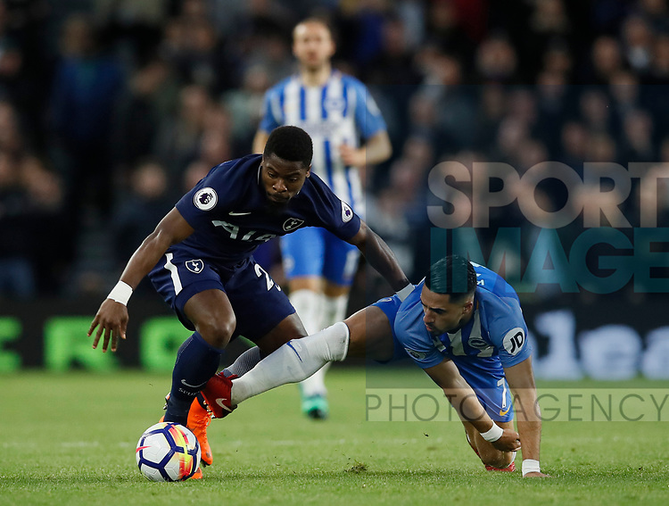 Serge Aurier of Tottenham tackles Anthony Kockaert of Brighton during the premier league match at the Amex Stadium, London. Picture date 17th April 2018. Picture credit should read: David Klein/Sportimage