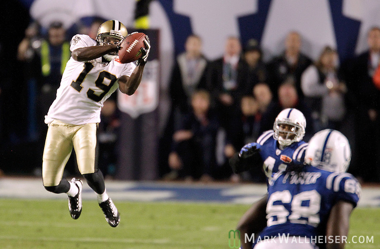 New Orleans Saints wide receiver Devery Henderson (19) makes a long gain in the third quarter of Super Bowl 44 NFL football game at Sun Life Stadium in Ft. Lauderdale, Florida February 7, 2010.  The New Orleans Saints defeated the Indianapolis Colts 31-17 in Super Bowl XLIV.